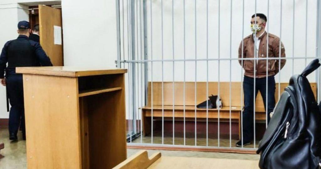 Belarus activist 'stabs his neck' in court